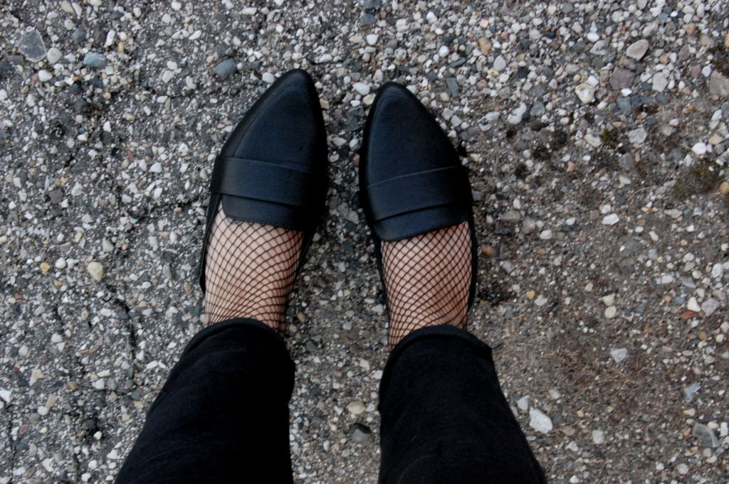 fishnet tights and loafers